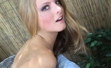 Skinny blonde stripping outdoors and masturbating