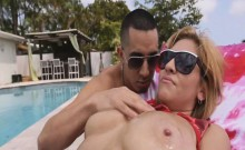 Jazmyn shows off tits and ass in pool