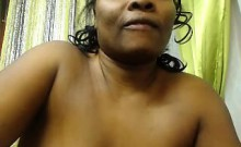 Dark skinned plumper with huge tits fingers her pink snatch