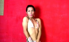 Naughty exotic femboy swirls her body and tickles hairy dick