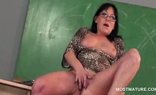 Dirty mature teacher giving BJ and masturbating on the desk