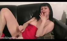 Horny smoking Mina masturbates her pussy on the couch