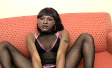 Ample ebony shemale in overall fishnet gives handjob in POV
