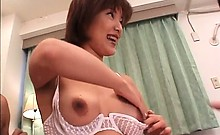 Jap babe in big tits licks her nipples and serves two dicks
